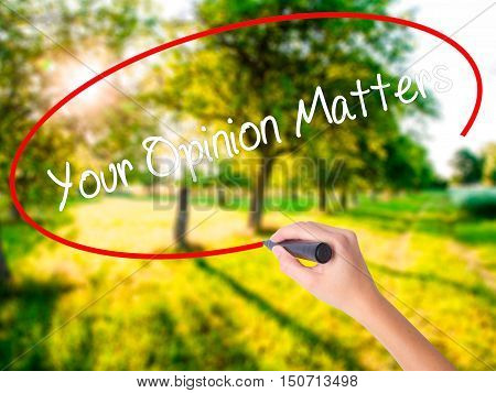 Woman Hand Writing Your Opinion Matters With A Marker Over Transparent Board