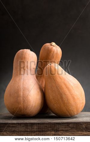 pumpkins on a wooden board