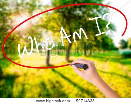 Woman Hand Writing Who Am I? With A Marker Over Transparent Board