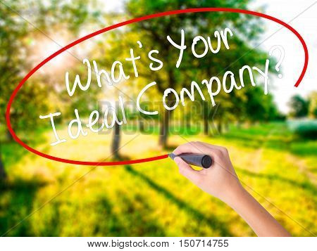 Woman Hand Writing Whats Your Ideal Company? With A Marker Over Transparent Board