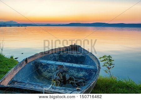 Sunset over Lake Balaton with a boat in the front
