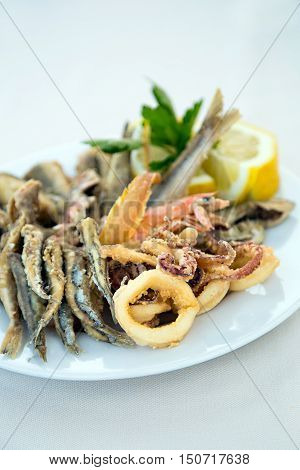 Catch of the day on the plate of mixed fried fish in Italy