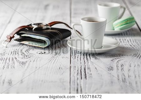 wallet with Watch and coffee cup on table