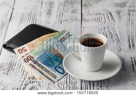 Euro Bill And Cup Of Coffee On Wooden Table. Payment, Tip.