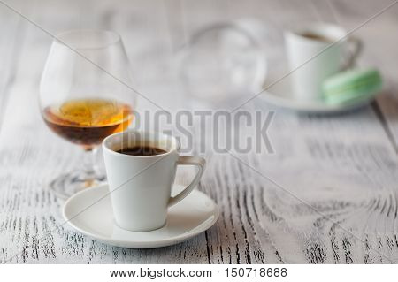 two cups of coffee and glass of cognac
