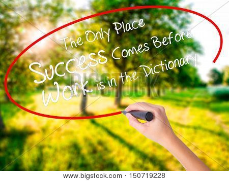Woman Hand Writing The Only Place Success Comes Before Work Is In The Dictionary With A Marker Over