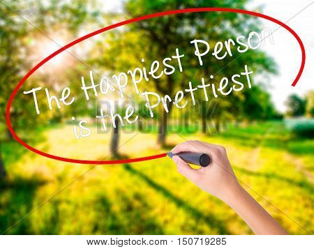 Woman Hand Writing The Happiest Person Is The Prettiest With A Marker Over Transparent Board .