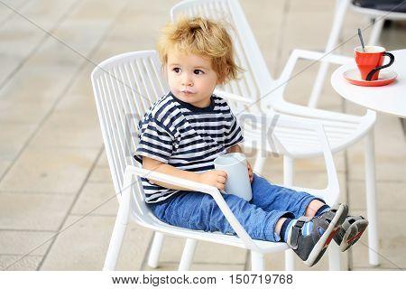 Boy Drinks Cup Of Milk