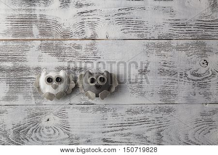 Handcrafted Owl on white shabby chic background