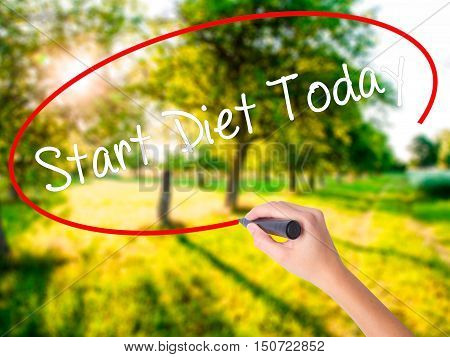 Woman Hand Writing Start Diet Today  With A Marker Over Transparent Board