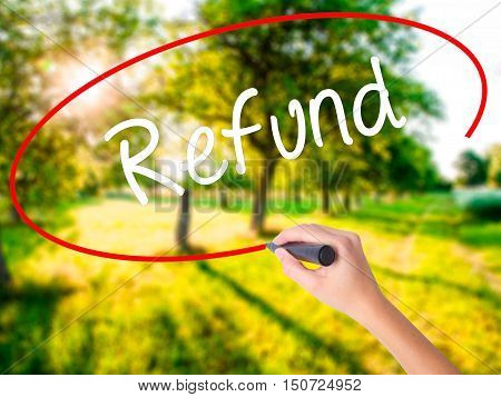 Woman Hand Writing Refund With A Marker Over Transparent Board
