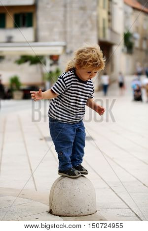 Baby Boy On Semisphere Bollard