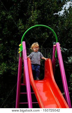 Cute Baby Boy On Slide