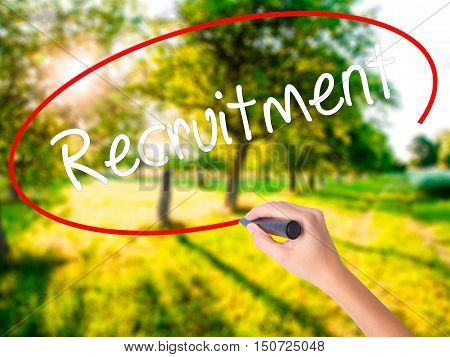 Woman Hand Writing Recruitment  With A Marker Over Transparent Board .