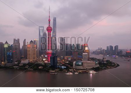 SHANGHAI - AUG 14, 2015: Oriental tower, Pudong District at evening, Oriental tower has height 468 m (1,535 feet), it was the tallest structure in China from 1994â??2007