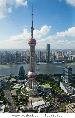 SHANGHAI - AUG 13, 2015: Oriental tower at sunny day, Oriental tower has height 468 m (1,535 feet), it was the tallest structure in China from 1994â??2007