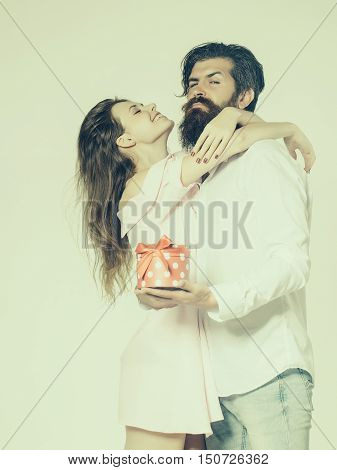 Young Happy Couple With Box