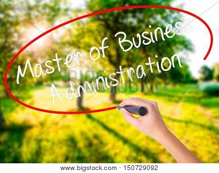 Woman Hand Writing Master Of Business Administration With A Marker Over Transparent Board