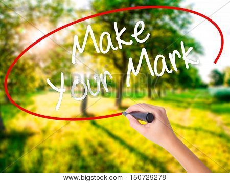 Woman Hand Writing Make Your Mark With A Marker Over Transparent Board