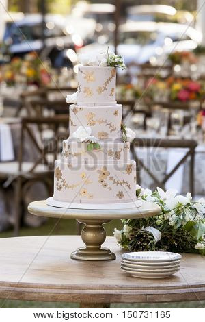 Four tier wedding cake with white roses