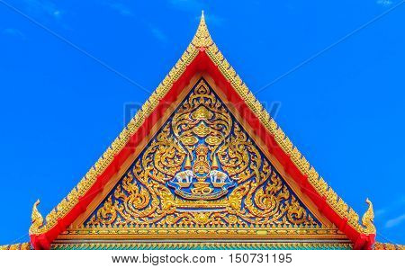 Roof gable Thai style temple. on sky background