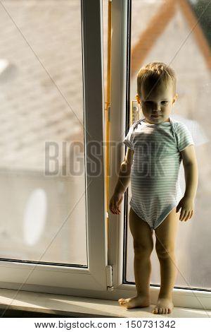 Baby Boy On Window Sill