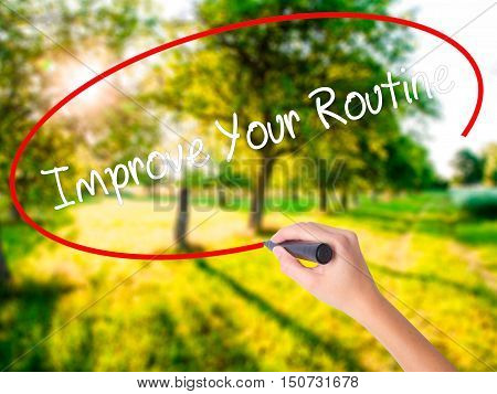 Woman Hand Writing Improve Your Routine With A Marker Over Transparent Board