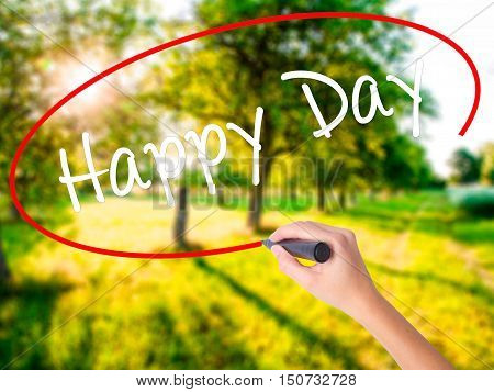 Woman Hand Writing  Happy Day With A Marker Over Transparent Board
