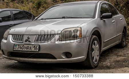 Kazakhstan, Ust-Kamenogorsk, october 5, 2016: Mitsubishi Galant, new car, japanese car in the street, sedan, gray