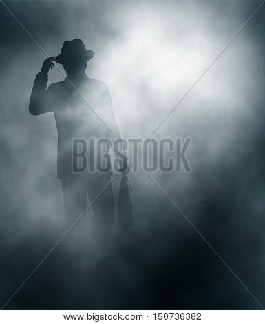 Editable vector illustration of a businessman in mist tipping his hat in greeting created using gradient meshes