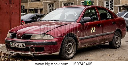 Kazakhstan, Ust-Kamenogorsk, october 5, 2016: Mitsubishi Carisma, old car, old japanese car in the street, taxi, old taxi