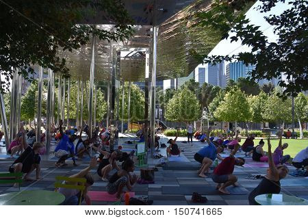 DALLAS, TX - SEP 17: Yoga session at Klyde Warren Park in Dallas, Texas, as seen on Sep 17, 2016. The urban park is open to the public, but is operated by the private Woodall Rodgers Park Foundation.