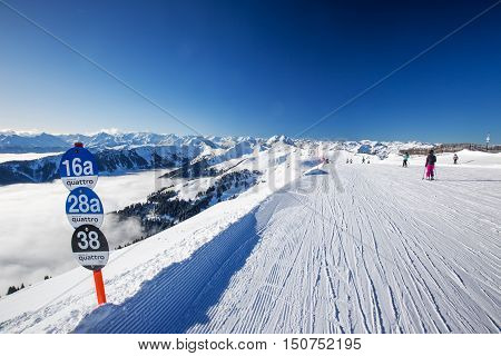 Kitzbuehel, February 18, 2016 - Skiers Skiing In Kitzbuehel Ski Resort And Enjoying Alps View From T