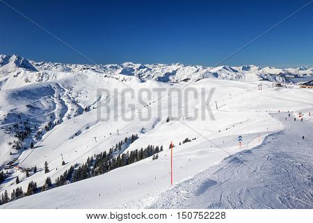 View To Alpine Mountains And Ski Slopes In Austria From Kitzbuehel Ski Resort - One Of The Best Ski
