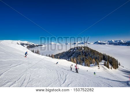 Kitzbuehel, Austria - February 18, 2016 - Skier Skiing And Enjoying The View To Alpine Mountains In