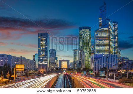 La Defense, Paris. Image of office buildings in modern part of Paris- La Defense during beautiful sunset.