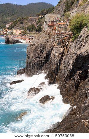 Rocky coast at Cinque Terre village Monterosso al Mare and Mediterranean Sea Italy