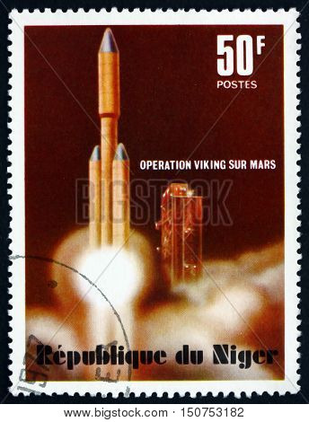 NIGER - CIRCA 1977: a stamp printed in Niger shows Titan Rocket Launch Viking Mars Project circa 1977