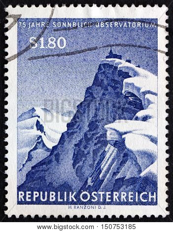 AUSTRIA - CIRCA 1961: a stamp printed in Austria shows Sonnblick Mountain and Observatory Sonnblick Meteorological Observatory 75th Anniversary circa 1961