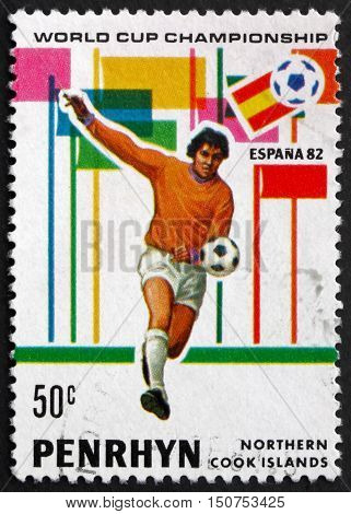 PENRHYN - CIRCA 1981: a stamp printed in Penrhyn shows Player in Action 1982 World Cup Soccer circa 1981