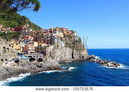 Cinque Terre village Manarola with colorful houses and Mediterranean Sea Italy