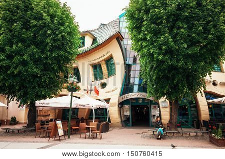 Sopot Poland - 5 June 2013: The Crooked house on the Heroes of Monte Cassino street in Sopot Poland. Crooked little house or Krzywy Domek is an unusually shaped building Rezydent shopping center.