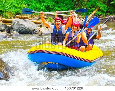 Bali Indonesia - April 11 2012: Rafting in the canyon on Balis mountain river Ayung at Indonesia