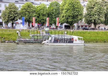 SALZBURG AUSTRIA - May 05.2012: Pleasure boat near the pier on the river Salz in city Salzburg