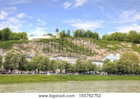 SALZBURG AUSTRIA - May 05.2012: Salz River Beach. The museum building on top of a cliff