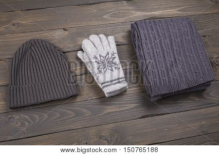 layout warm clothes top view on a wooden board