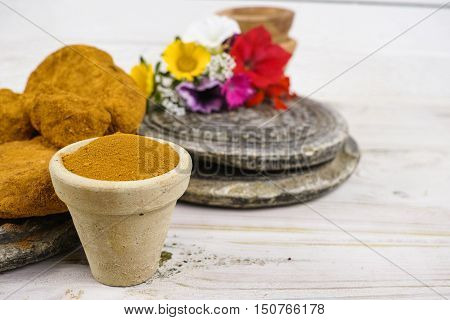 Ancient minerals - bright ochre stones and powder for spa and natural color paint pigment