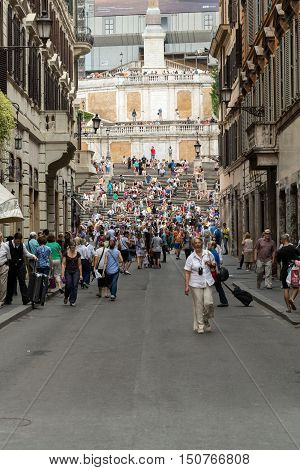ROME ITALY - JUNE 15 2015: Spanish Steps and Via Condotti in Rome. This street is the center of fashion shopping in Rome with the atelier of Bulgari Armani Cartier Fendi Gucci  and others.