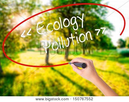 Woman Hand Writing Ecology - Pollution With A Marker Over Transparent Board