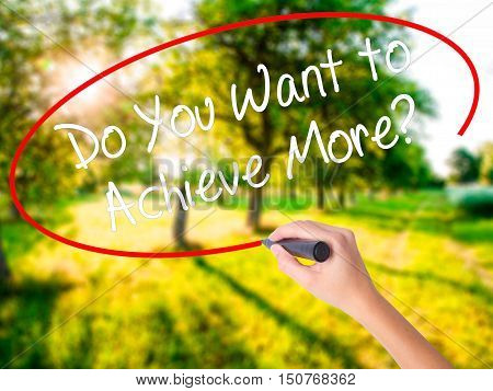 Woman Hand Writing Do You Want To Achieve More? With A Marker Over Transparent Board